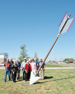 Members of the Carson County Historical Commission share a moment of consideration to their dedication and long hours of research and commitment following the installation of the Quanah Parker Trail Arrow marker east of the Carson County Law Enforcement Center in Panhandle. Photo courtesy of Barbara Brannon/Texas Plains Trail Region