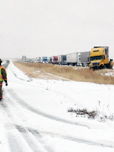 More than 100 tractor trailers created a backup in the westbound lane of traffic on I-40 and FM 2373. The Amarillo District for the TxDOT and local law enforcement responded to 148 crashes from Friday, Nov. 22 to Sunday, Nov. 24. A total of five people died in these crashes in a pile up near Vega. The total number of injured persons during the three day period was not available. Photo courtesy of Terry Coffee