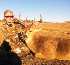 Kinsey Brown smiles brightly for the camera following her kill of her first buck. Kinsey made the shot on Dec. 12, 2013 at Allison, Texas. The buck sported an eight-point rack.