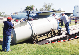 Pantex employees offload the empty shell of the last B53 nuclear weapon at the Freedom Museum in Pampa, dedicated to honor those brave men and women who sacrificed for Amercian's freedoms. The museum exhibits both military and civilian artifacts and memorabilia of American military history.  ©2014 by Jim McBride/Amarillo Globe News