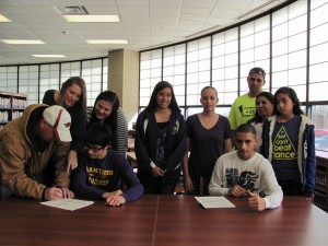 The families of Bryce Cathey and JJ Gonzalez stood by as both boys signed with Oklahoma Panhandle State University as part of the Men's Cross-Country Team last Wednesday morning.