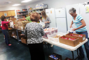 Claire Crutchfield, Janie Haiduk, Vanita Sloan, Lynda Paul, Nancy Garrison, Alyssa Roper and Peggy Chaney busy setting up and packing snack bags for distribution.