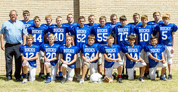 Little Bucks Football Team, back row (l to r): Drake Damron, Jasper Chaney, Cy Darrow, Hunter White, Dathan Bosley, Jesse Valusek and Mason Mooney. Middle row: Coach Shemwell, John Perriman, William Sirmans, Raven Olney, Preston Sons, Jayden Mynear, Graysen Smith and Trystan Hunter. Front row: Tyler Boyd, Hunter Warminski, Nick Mize, Colt Pelfrey, Konner Anderson, Kayden Johnson and Yahir Rodriguez.