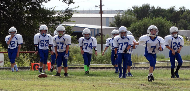 Third and forth grade Mean Machines take the field.